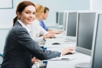 Business woman in front of computer screen