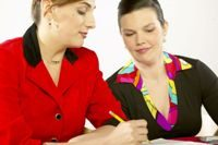 two women at a table writing up an agreement
