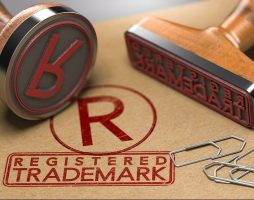 two stamps with text registered trademark and the symbol R